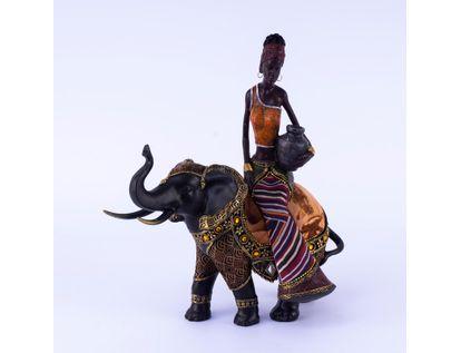 figura-de-mujer-africana-con-falda-a-rayas-sentada-sobre-elefante-7701016957618